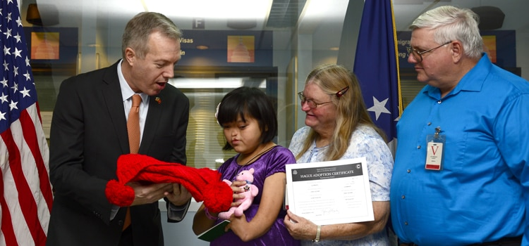 Ambassador Delivers the First Inter-Country Adoption Visa