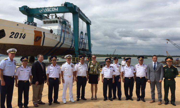 Adm. Harris, Consul General Tarnowka, and Vietnam Coast Guard officials visit the boat haul-out facility.