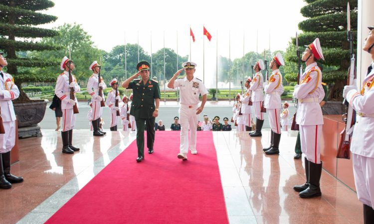 Vietnam People's Army, Chief of the General Staff and Deputy Minister of National Defense, Lt. Gen. Phan Van Giang, left, and Adm. Harry Harris Jr., commander of U.S. Pacific Command, render honors during an honor ceremony at the Ministry of National Defense.