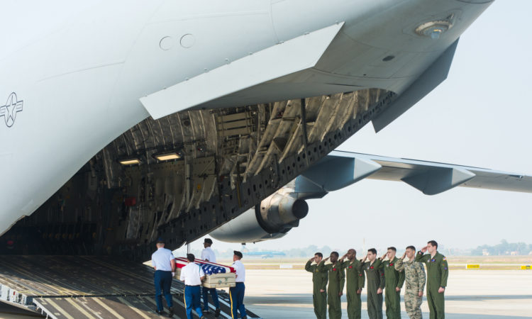 A U.S. military honor guard transfers remains believed to be those of U.S. personnel missing from the Vietnam War to a United States Air Force aircraft for repatriation to the United States.