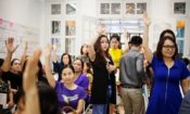 Entrepreneurs raise their hands as they participate in a workshop at the WECREATE | Vietnam Center in Hanoi, launched in October 2016. [Photo courtesy of WECREATE | Vietnam]