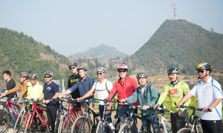 The U.S. Embassy delegation bikes from Cot Co Lung Cu to a nearby Lo Lo village