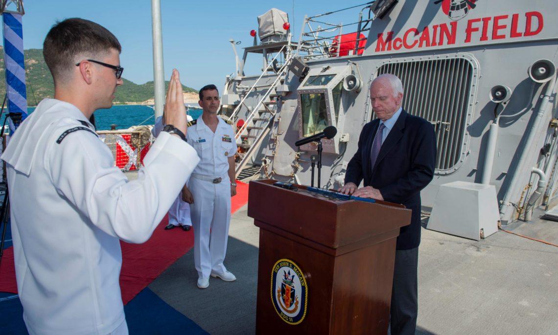Senator John S. McCain III reenlists the ship's sailor of the year Electronics Technician 2nd